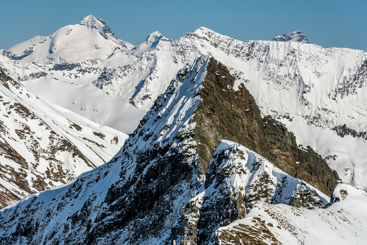 The unclimbed east ridge of Sharks Tooth Peak, facing the photographer at centre image. Mount Earnslaw, O'Leary Peak and Sir William Peak in the background