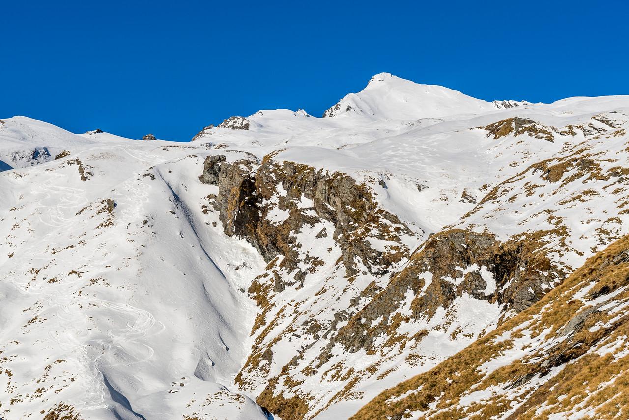 Fog Peak at the head of Wishbone Creek - with heli-skiers tracks