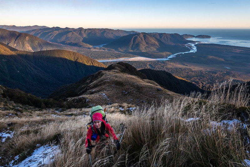 Climbing above Thirsty Ridge, Haast Range. Arawhata River and Jackson Bay below.