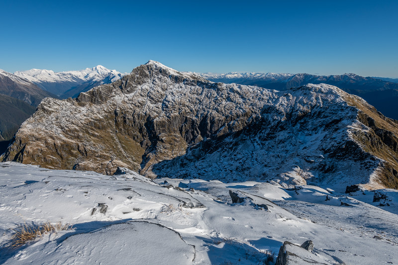 View of Mount Duncan from Pt 1643m, Haast Range. Rob Roy Peak and Mount Aspiring back left; the Olivine Ranges on right.