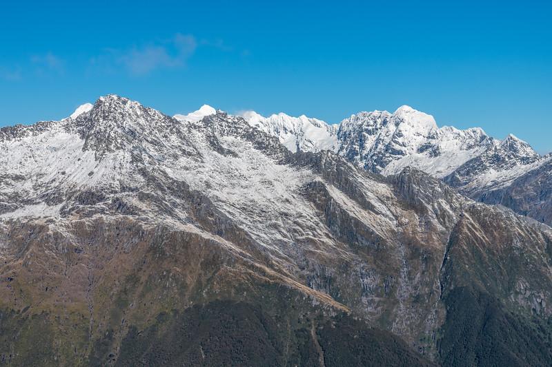 Panorama from Pt 1643m, Haast Range. FRom left to right are Mt Castor, Rosy Peak, Mount Pollux, Sombre Peak, Helena Peak, Munro Peak, Flanagans Summit.