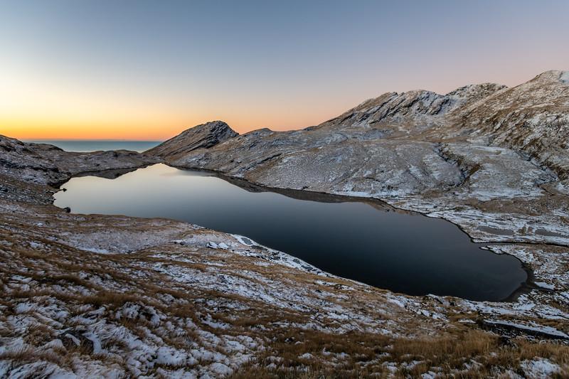 Lake Greaney at sunset. Haast Range.