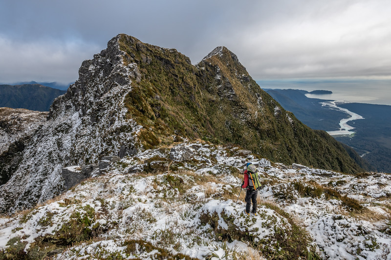 On the ridge of Mount Heveldt. Arawhata River and Jackson Bay below.