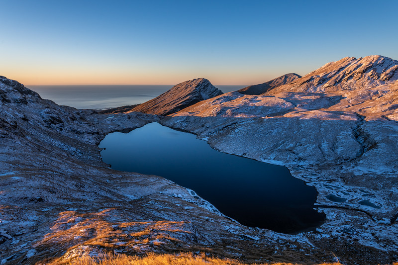 Mount Heveldt and Lake Greaney at sunset. Mount Watney back right.