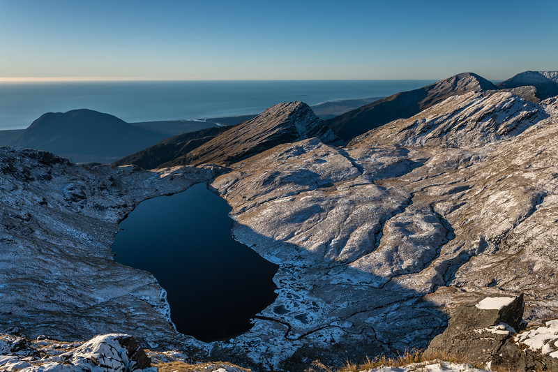 Lake Greaney and Mount Watney from Pt 1643m, Haast Range. Mount McLean is the bushclad hill behind Lake Greaney.