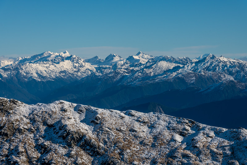 View of the Olivines from Pt 1643m, Haast Range. From left to right are Destiny Peak, Climax Peak, Blockade Peak, Intervention Ridge, Ark and Mt Tutoko (in the far back).