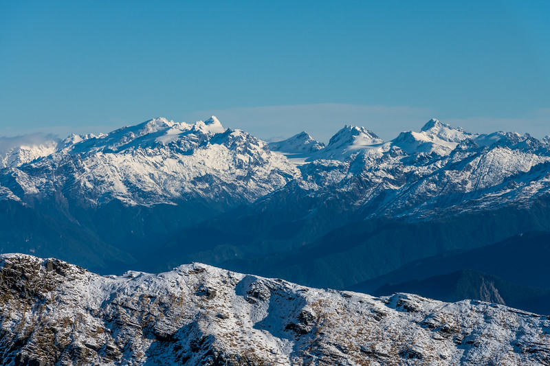 View of the Olivines from Pt 1643m, Haast Range. From left to right are Destiny Peak, Climax Peak, Blockade Peak, Intervention Ridge, Ark. The Olivine Ice Plateau is at centre image.