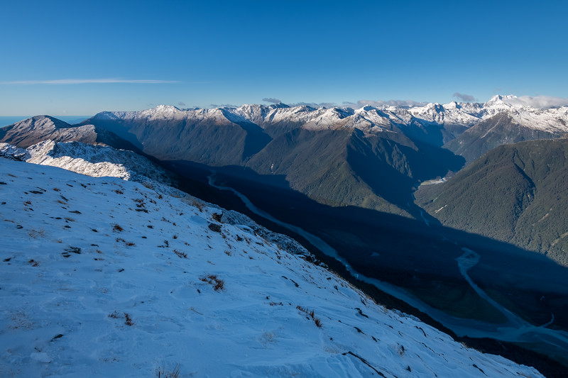 View from Pt 1643m, Haast Range. Waiatoto and Te Naihi Rivers, looking up to Mount Alba (on far right). Mount Watney on far left and the Selborne Range at centre image.