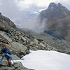 Scrambling under Mt Chaos. Lake Unknown and Mt Nox in the background.