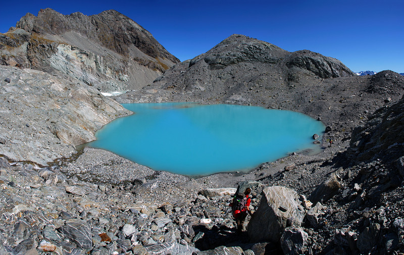Tarn at the toe of Park Pass Glacier. Amphion Peak above