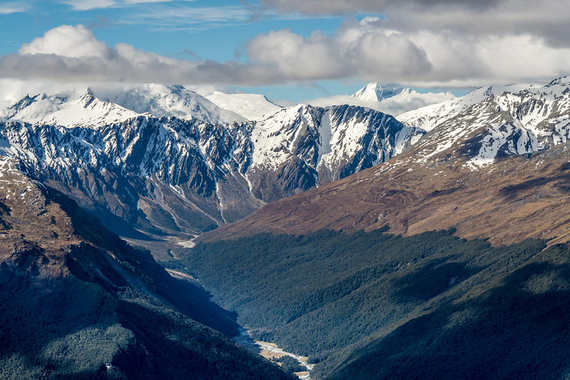 View into the head of the Rees Valley from Lennox Pass. Mount Cunningham is just right of centre image, with Mount Aspiring (top in cloud) further back.