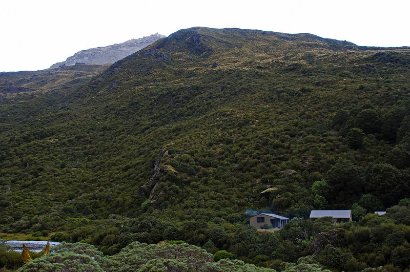 Shelter Rock Hut, Rees Valley. The west shoulder of Cleft Peak (1992m) above.