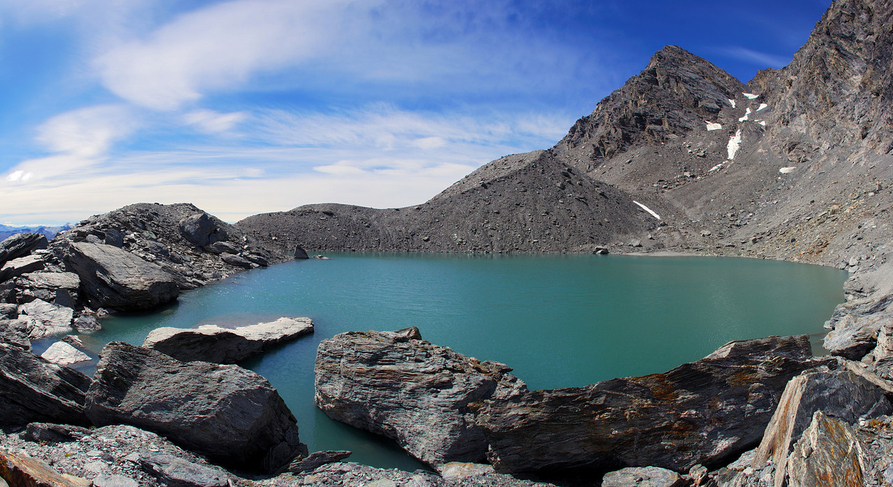 Lake at 2120m of elevation at the head of Glencairn Creek. The West Centaur Peak above