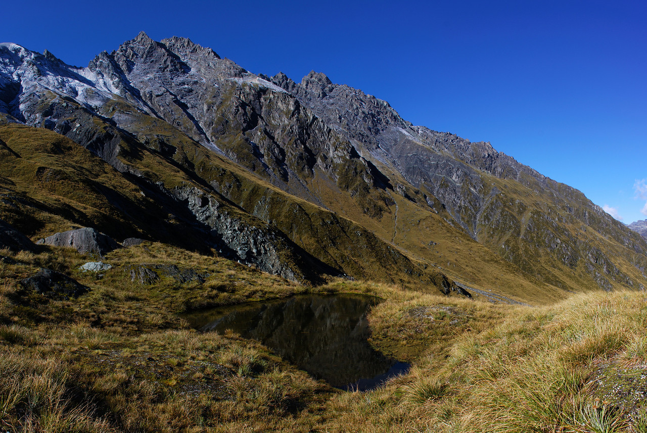 Tarn on Rees Saddle. Unnamed peak 2234m (centre-left) and Cleft Peak (centre) above