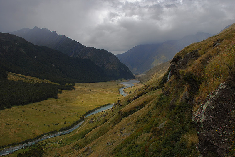 Looking down the Matukituki River West Branch from the slopes below Shotover Saddle. Brides Veil Waterfall is in the foreground