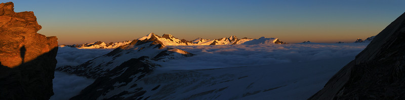 Early morning panorama from Mt Tyndall's west ridge. The peaks above the Dart Glacier, from Mt Edward to Mt Liverpool, are at centre image