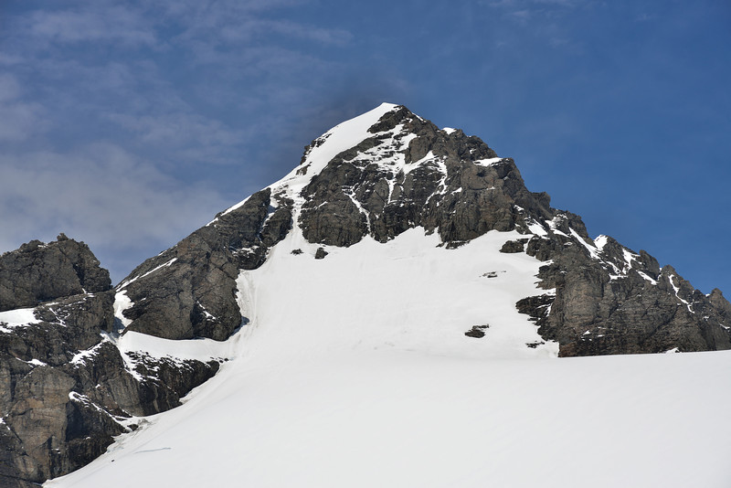Mount Ian's summit pyramid from the north. The easiest route to the summit seems to be via the small couloir on the far left, although there are a number of lines zig-zagging up the west face that would also go