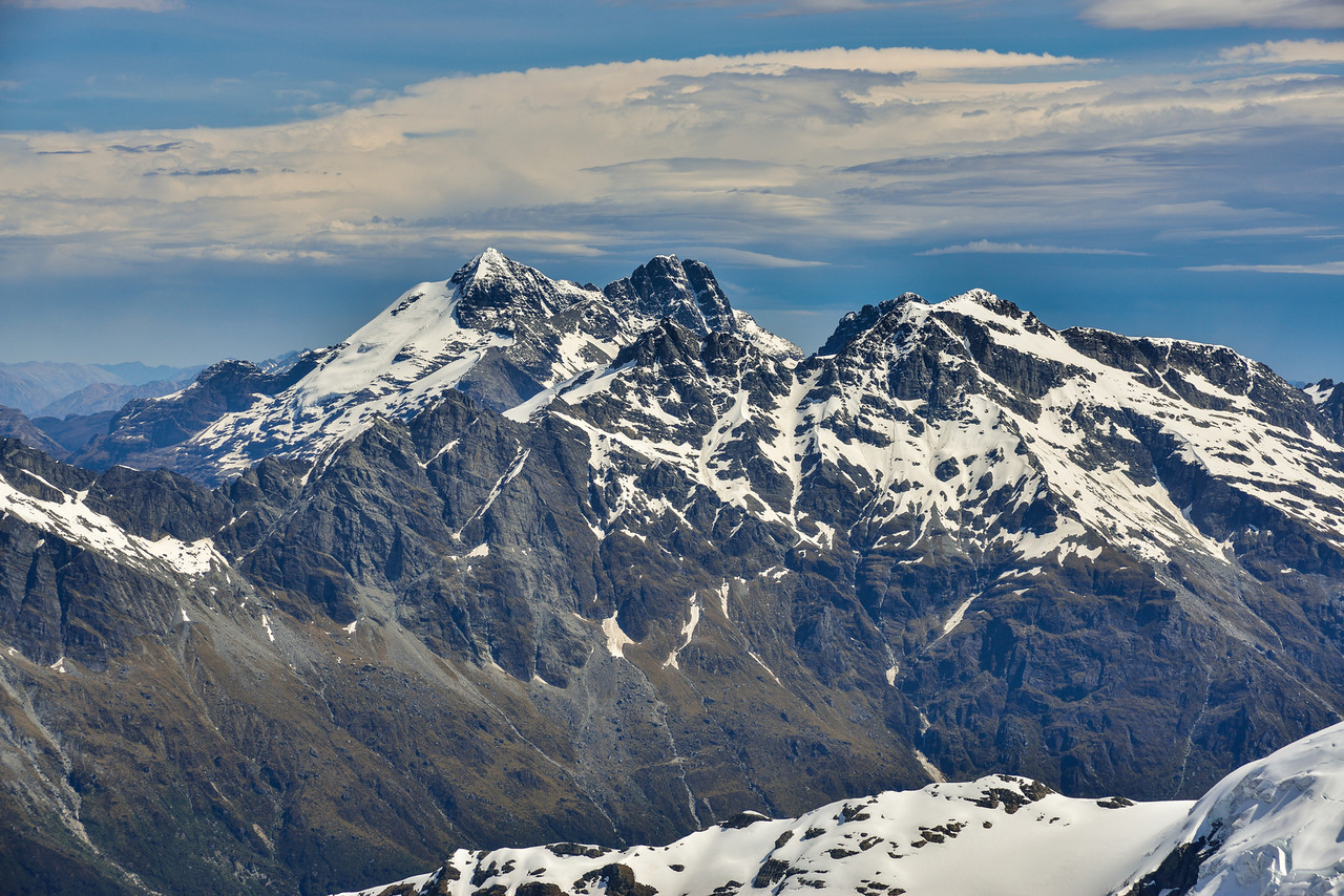 The Forbes Mountains from Mt Lydia. Mt Earnslaw (East and West Peaks) is just left of centre image, Moira Peak is right in front of Earnslaw's West Peak, while Mt Head is on the right, with Sir William Peak behind