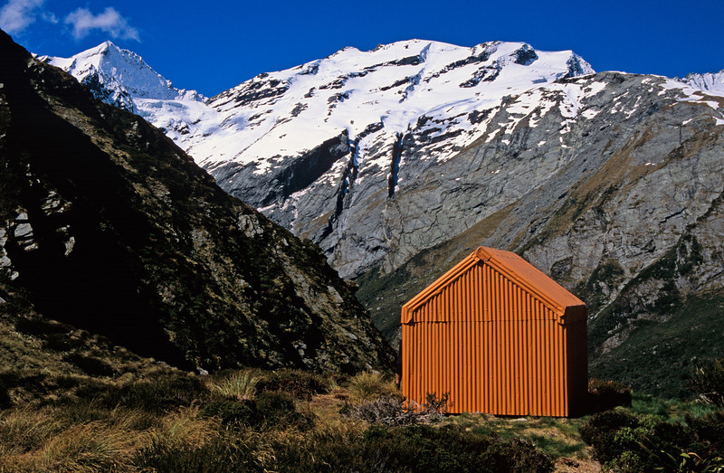 Liverpool Hut in front of Mt Aspiring, Mt French and the Quarterdeck
