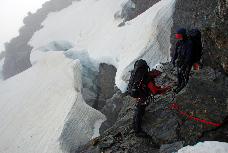 Preparing to abseil at the base of the south face of Irvine Peak