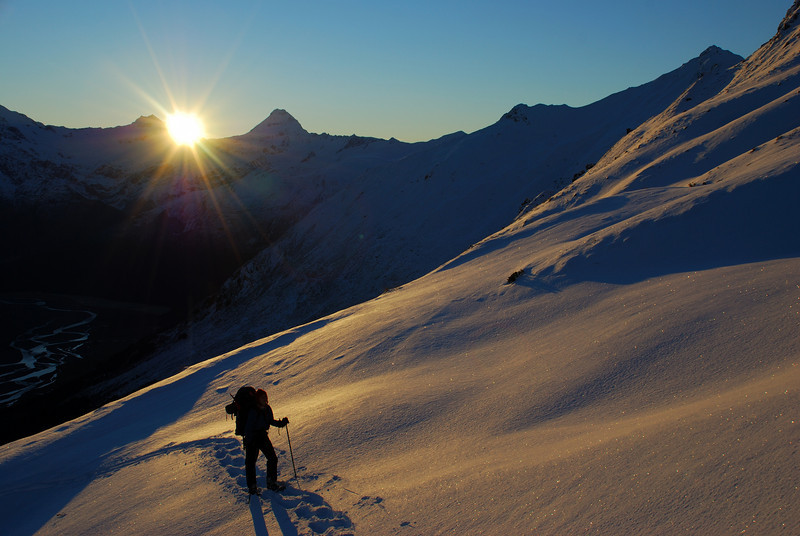 Snow shoeing on Round Hill Spur. Mount Aspiring and Triple Peak's southern outlier 1912m in the back