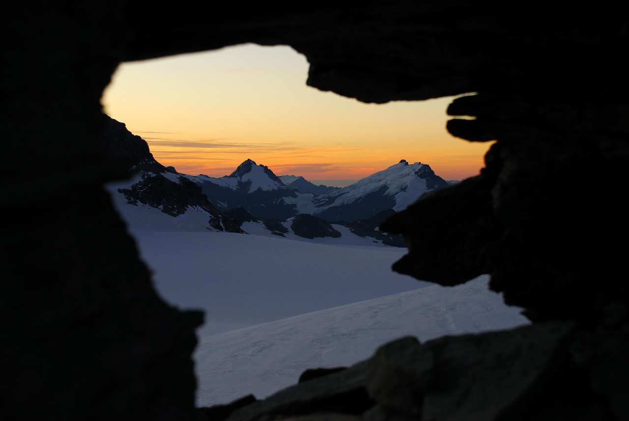 Mt Ionia and Eros through a window in the ridge at the edge of the Kitchener Cirque.