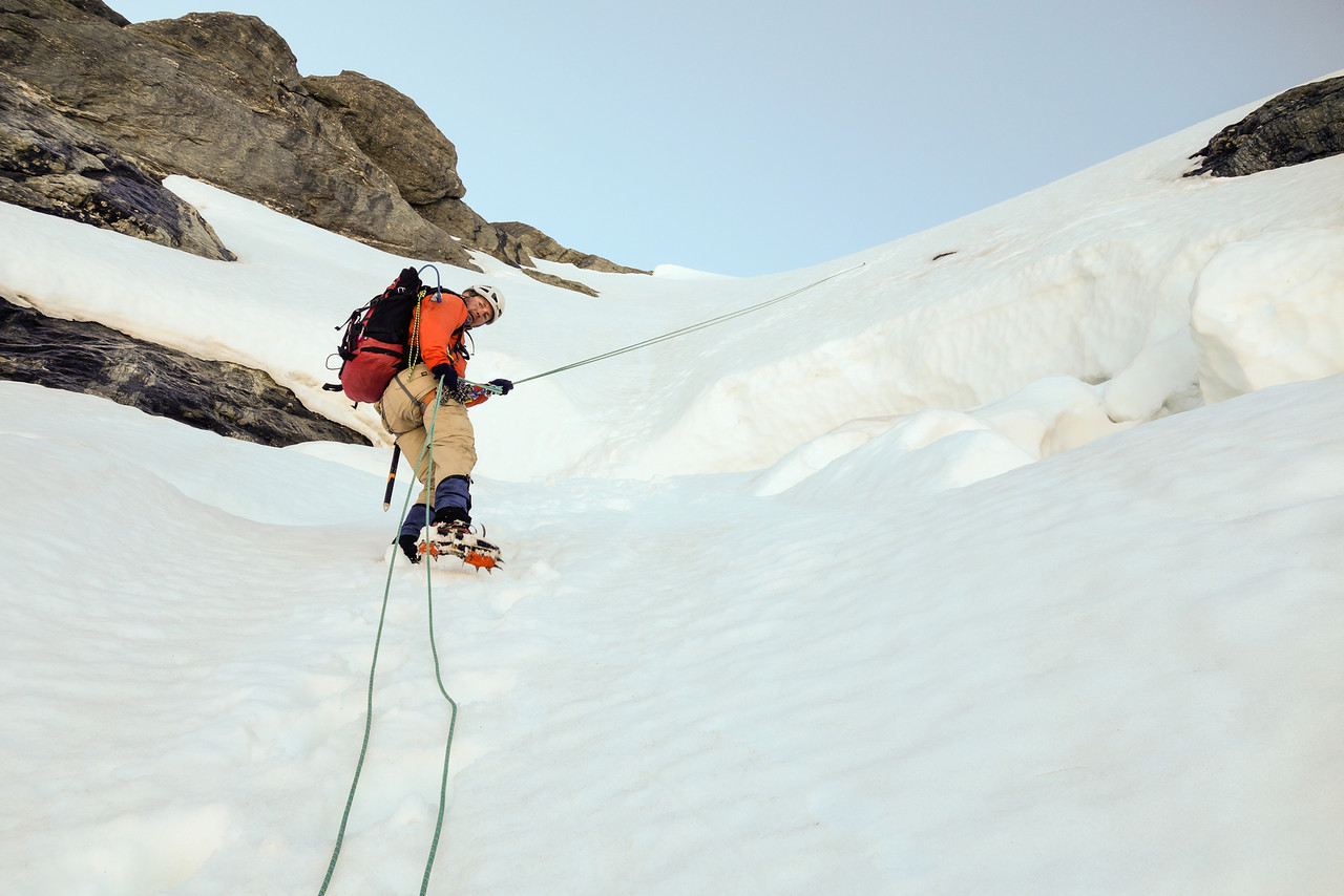 Abseiling across the schrund on Mt Awful's snow field