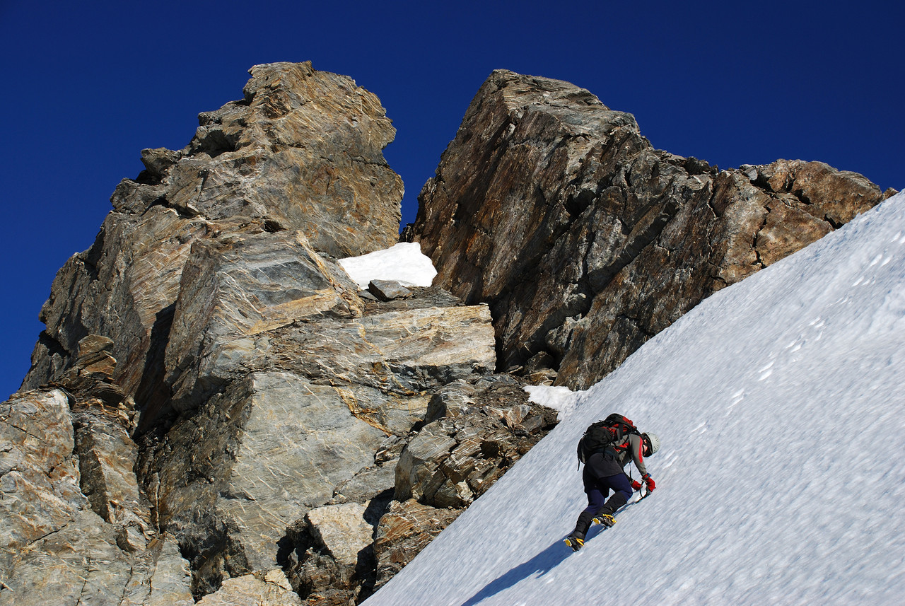 Kat below the summit pinnacle of Mount Ferguson.