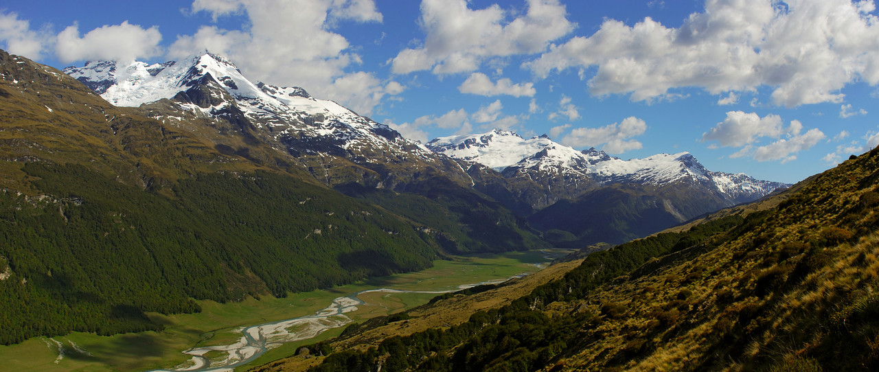 Panorama of the Forbes Mountains from Broad Spur. From left to right are Mount Earnslaw, O'Leary Peak, Mount Head, Moira Peak, the OSONZAC Twins and Mount Clarke. The Rees River in the foreground.