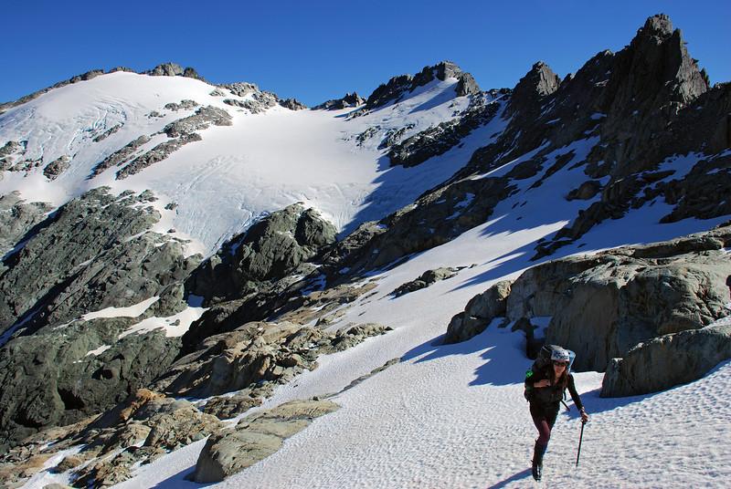 Heather traversing the tops south of Nereus Peak
