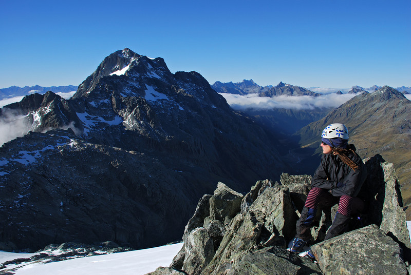 Heather on the summit of Nereus Peak. Somnus and the North Routeburn in the back.