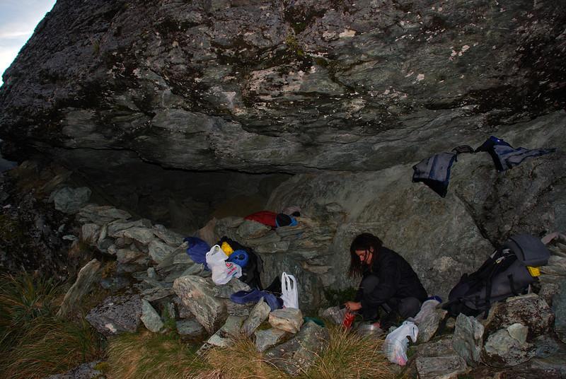 Preparing dinner in the rock bivvy below North Col