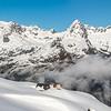 On Harris Saddle. On the skyline in the background are Consolation Peak, Triangle Peak, Ngatimamoe Peak, Mount Lyttle, Mount Christina, Mount Gunn, Mount Gifford.
