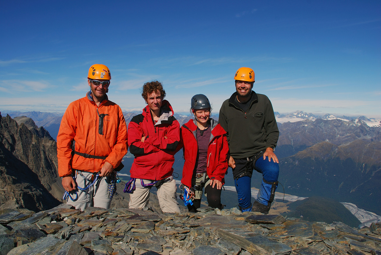 Smiley team on the summit of Pluto Peak