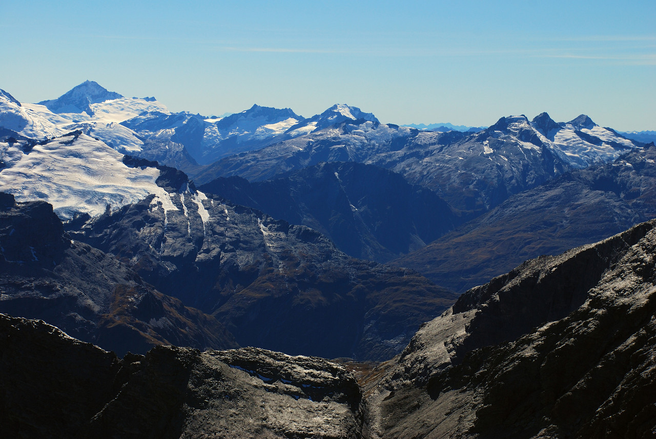 View from Pluto Peak, looking over Shepherds Pass, Rees Saddle and Cascade Saddle. The peaks on the horizon are Mt Aspiring, Mt Avalanche, Rob Roy Peak, Headlong Peak and Mt Tyndall