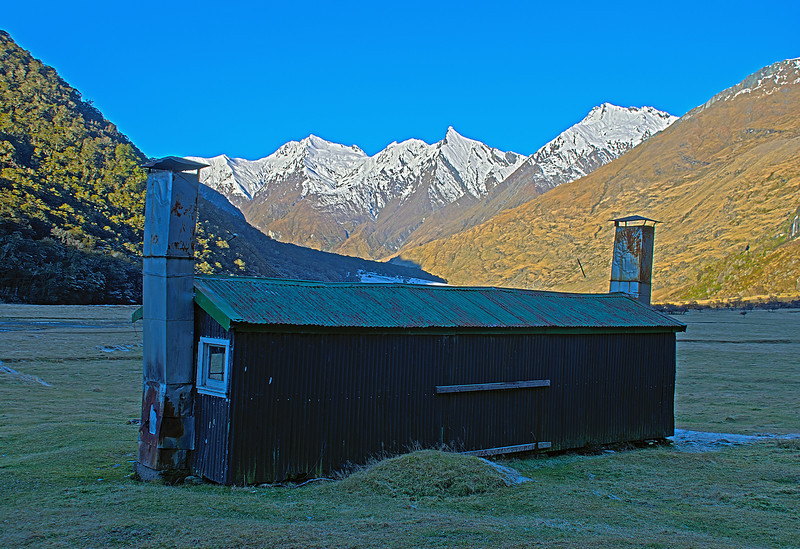 Cascade Hut. Fog Peak, Sharks Tooth Peak and Craigroyston Peak behind
