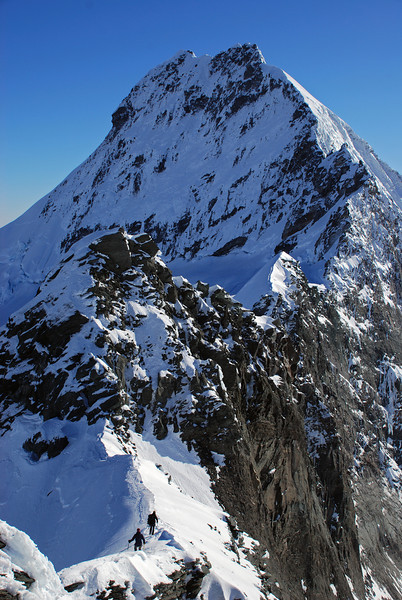 On the summit ridge of Popes Nose. The Coxcomb Ridge of Mt Aspiring behind