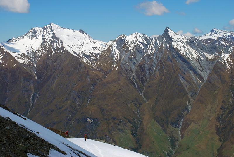 Descending the south ridge of Rob Roy Peak. Fog Peak, Sharks Tooth Peak and Black Peak behind.