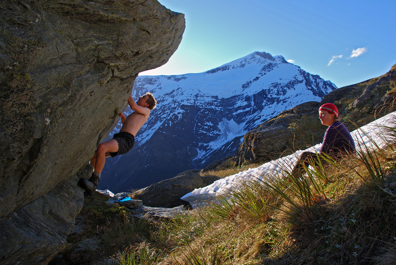 Jaz bouldering at the Rob Roy bivvy rock. Islington Dome in the back.