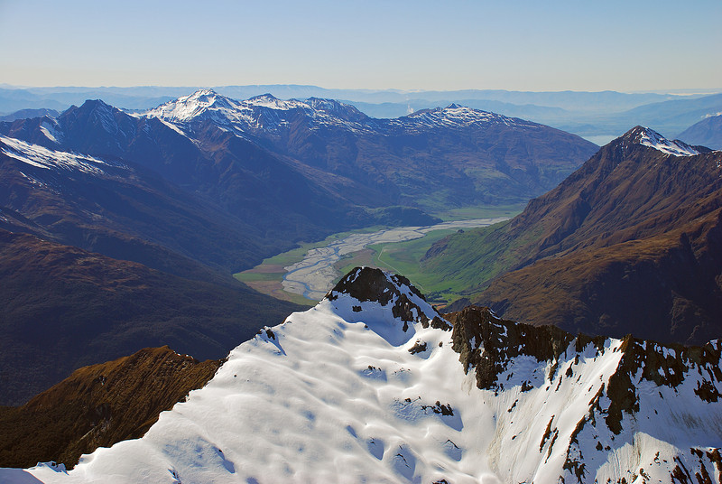 View into the lower Matukituki River from Rob Roy Peak: Homestead Peak in the foreground; Triple Peak, Mount Alta, Buchanan Peaks and Niger Peak behind.