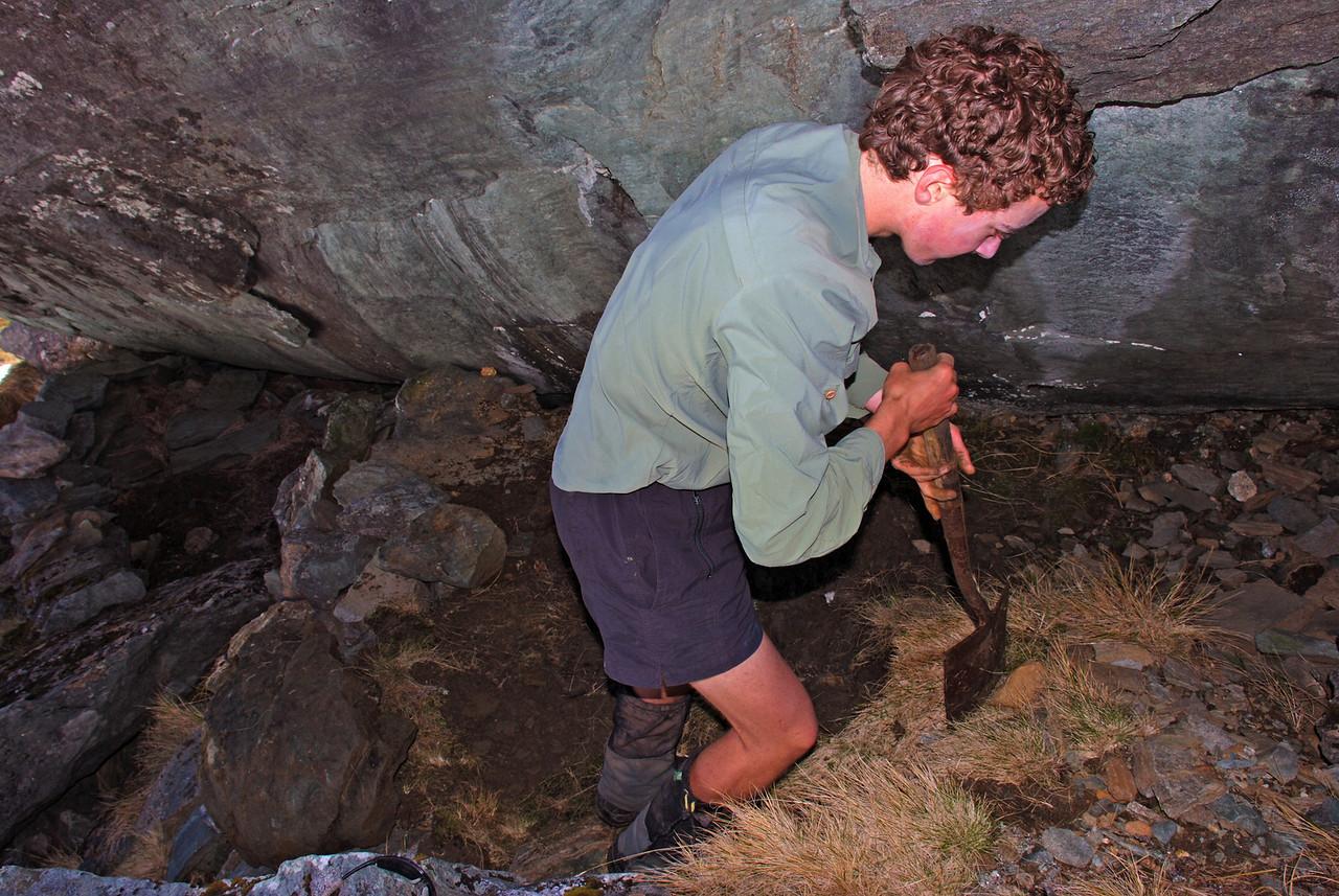 Jaz working to improve the Rob Roy bivvy rock. Spade kindly provided...