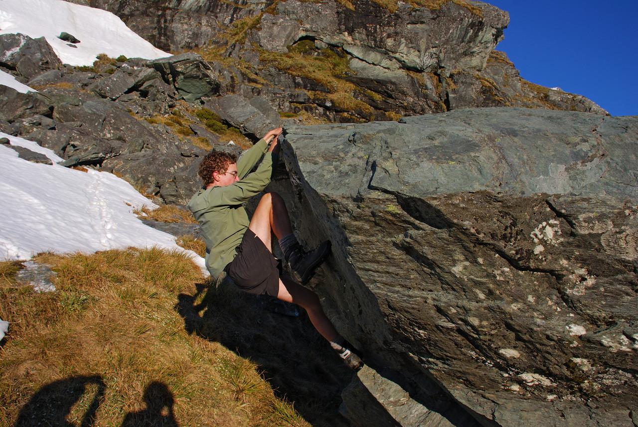 Jaz bouldering at the Rob Roy bivvy rock.