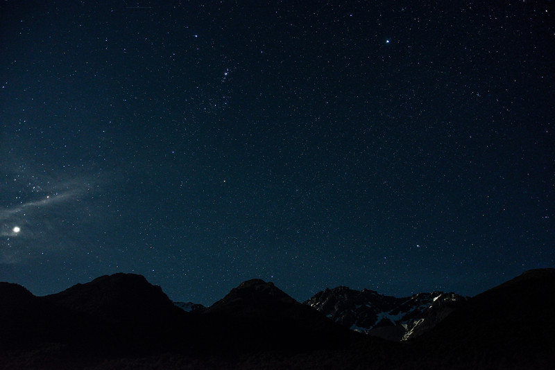 The constellation of Orion in a starry sky above Mount Bonpland
