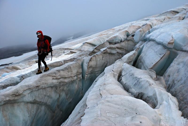 Jaz navigates his way through crevasses on the Frances Glacier, on the way to Sir William Peak.