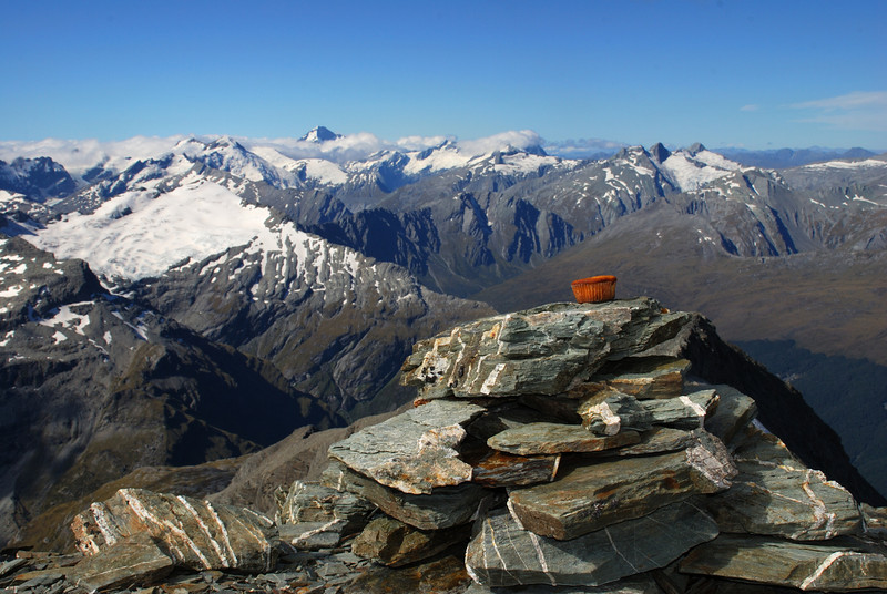 On the summit of O'Leary Peak. From left to right on the sky-line are Mt Maoriri, Mt Edward, Mt Aspiring, Mt Avalanche, Rob Roy Peak (in cloud), Headlong Peak, Mt Tyndall.