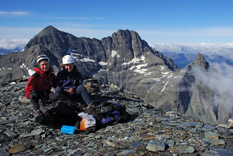 Jaz and Nina on the summit of Sir William Peak. Mt Earnslaw and Pluto Peak in the background.