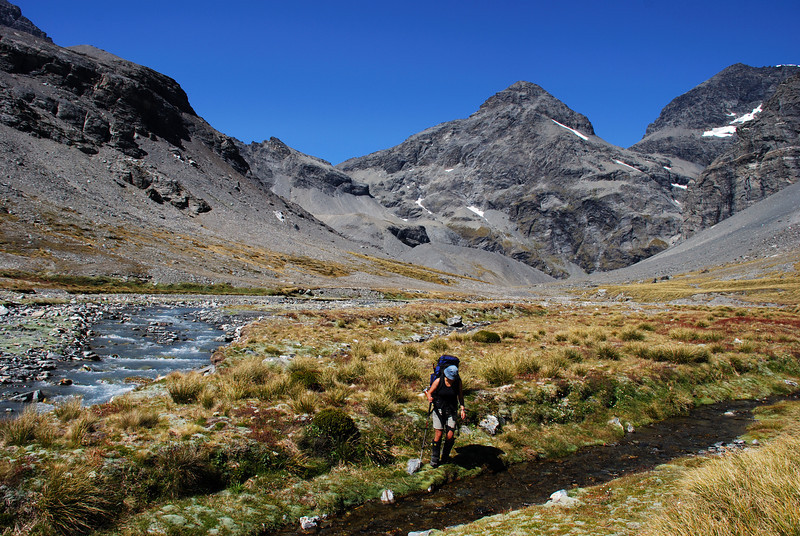 Nina in the Bedofrd Valley. O'Leary Peak (centre) and Mt Earnslaw East Peak (right) above.