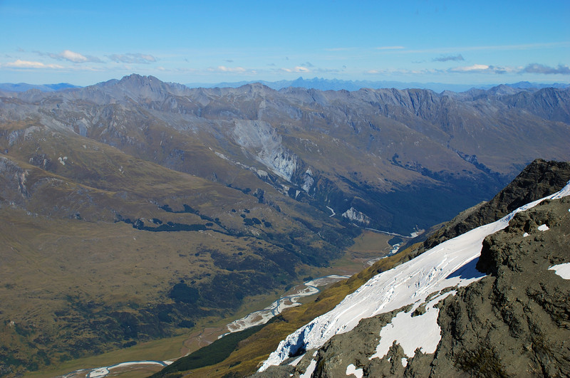 Looking south from Luncheon Col, over the east face of Mt Earnslaw and the Rees River. The Remarkables are visible on the horizon.
