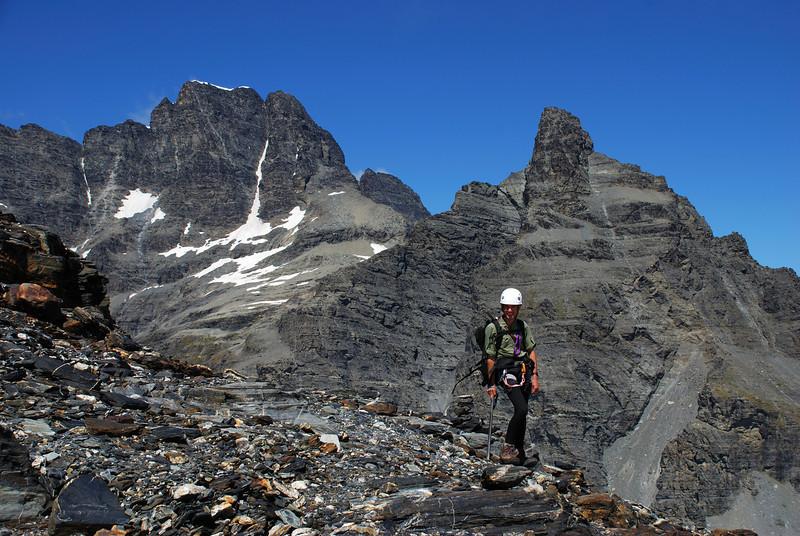 Jaz below the Frances Glacier. Mt Earnslaw West Peak and Pluto Peak behind.