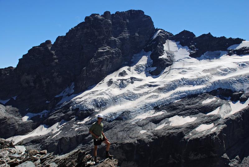 Jaz on the north-east ridge of O'Leary Peak. Sir William Peak in the background, south ridge on the left, north-east ridge on the right.